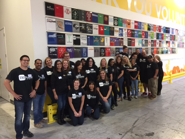 TRI Pointe Homes Suppports Make A Difference Day by helping out at Alameda County Community Food Bank.